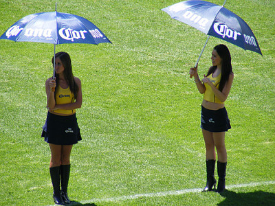 Sexy Corona Latina Beer Girls wearing short tight mini skirts up blouse with umbrellas during a promotional job