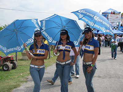 Sexy Corona Beer Girls with umbrellas wearing tight jeans wanting to become a promotional model for Boost Sales and Marketing,LlC