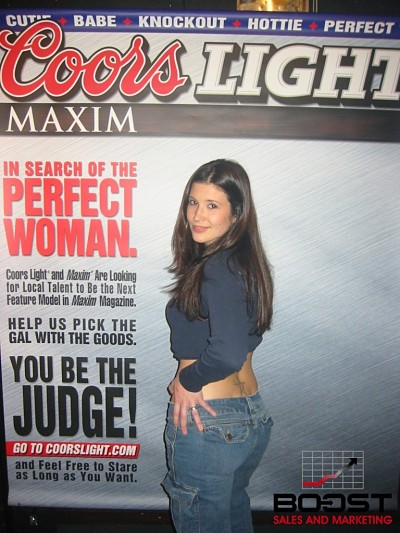 She has a fat ass and wants to become a promotional model for coors light beer.  she also is a Sexy Coors Light Maxim Girl Search - she is wearing a blue shirt and wants to get wild