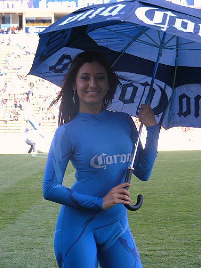 latina corona beer girl - sexy latina model holding an umbrella -wearing a tight corona beer girl outfit